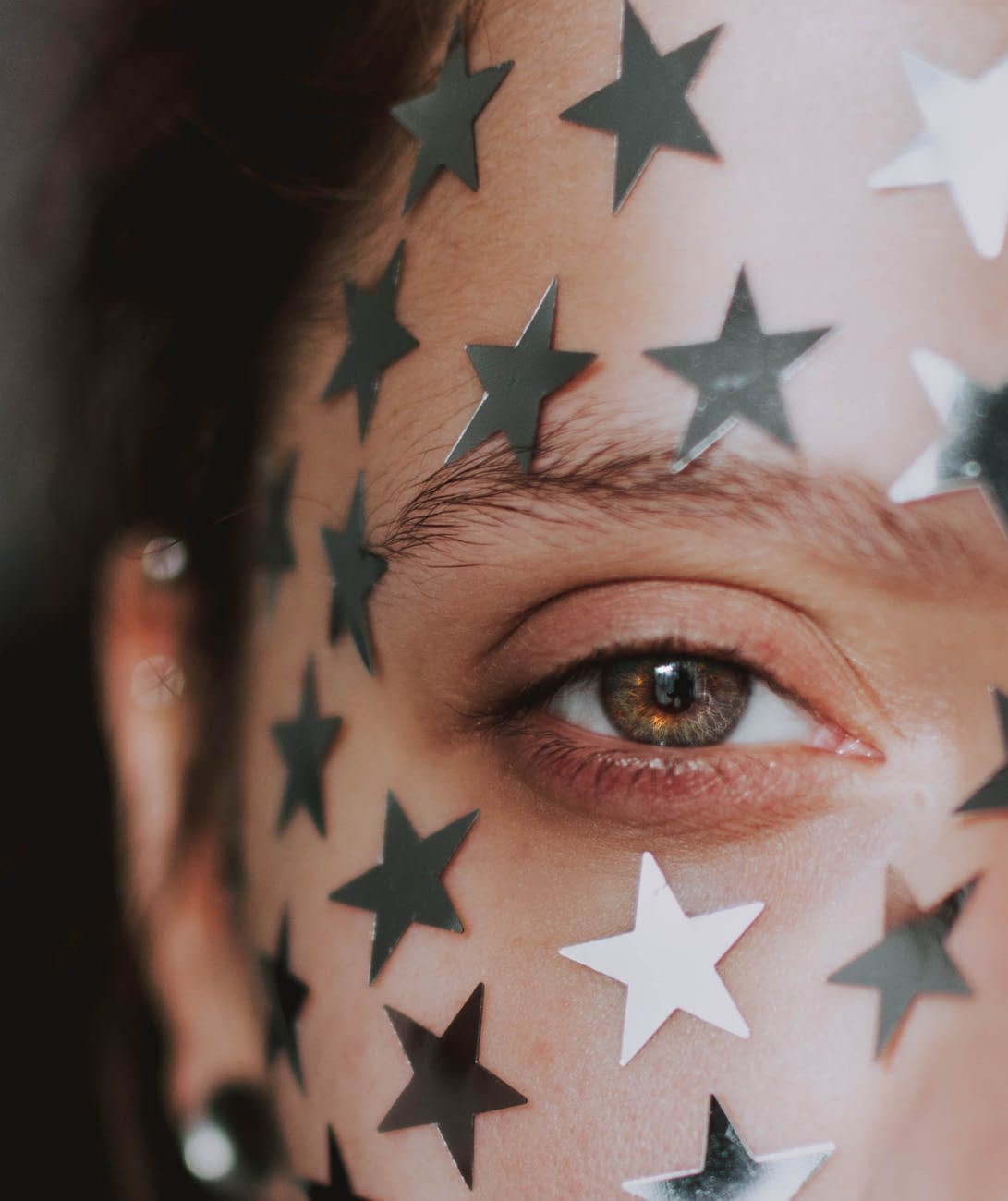 woman with star on face